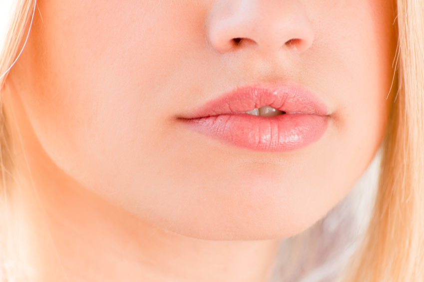 plump lips beautiful blonde on a white background closeup
