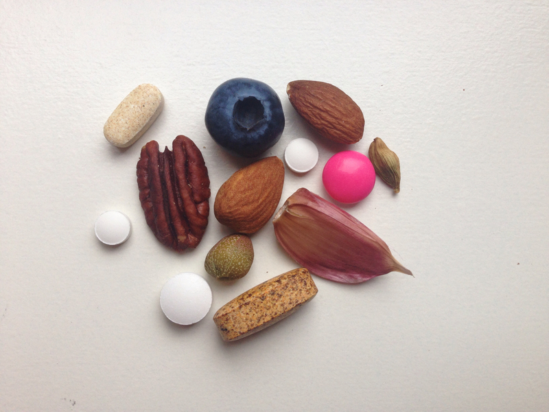 pills vitamins and fruits, nuts